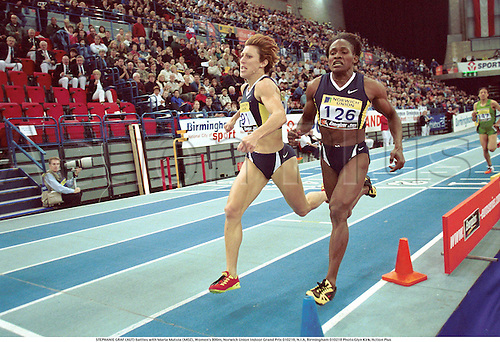 STEPHANIE GRAF (AUT) battles with Maria Mutola (MOZ), Women's 800m, Norwich Union Indoor Grand Prix 010218, N.I.A, Birmingham 010218 Photo:Glyn Kirk/Action Plus...Athletics.Distance.2001.woman.track and field.female Steffi Stephie