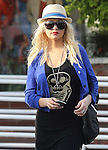 ...March 30th 2012 ..Christina Aguilera shopping at Fred Segal in Los Angeles with her brother . She was wearing no bra with her nipple showing & maybe pregnant again with little baby bump. Wearing diamond sunglasses red lipstick black leather purse handbag skull skeleton shirt blue jacket sweater  with zebra painted nails ..AbilityFilms@yahoo.com.805-427-3519.www.AbilityFilms.com