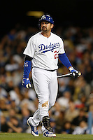 Adrian Gonzalez #23 of the Los Angeles Dodgers returns to the dugout after striking out against the Colorado Rockies at Dodger Stadium on April 30, 2013 in Los Angeles, California. (Larry Goren/Four Seam Images)
