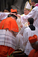 Canadian cardinal Gerald Cyprien Lacroix  receives his beret as he is being appointed cardinal by Pope Francis  at the consistory in the St. Peter's Basilica at the Vatican on February 22, 2014.