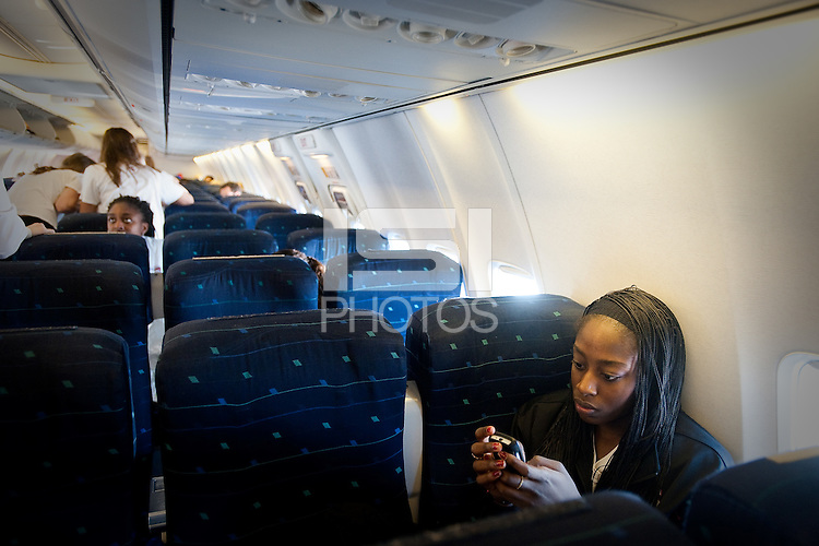 SAN JOSE, CA - MARCH 31, 2011: Chiney Ogwumike waits for take off en route to the NCAA Final Four at the San Jose International Airport on March 31, 2011.