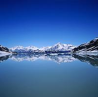 Alaskan landscape of Reid Inlet - blue sky and reflections. Glacier Bay National Park, Alaska.