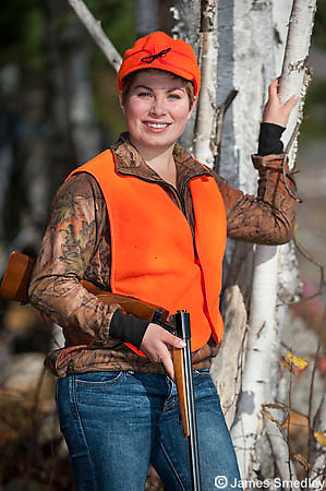 Young woman grouse hunting.