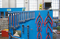 Switzerland. Canton Ticino. Bellinzona. Officine FFS. Stabilimento Industriale SBB CFF FFS Cargo. Railway workers on strike. Building's occupation. Industrial repair and assembly shop for carriages and locomotives axles. Machines are off and still. A green puppet and a picture of a dog. © 2008 Didier Ruef