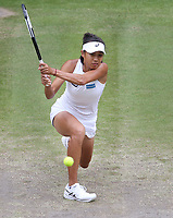 Shuai Zhang (CHN) during her match against Simona Halep (ROU)  in their Ladies' Singles Quarter-Finals match<br /> <br /> Photographer Rob Newell/CameraSport<br /> <br /> Wimbledon Lawn Tennis Championships - Day 8 - Tuesday 9th July 2019 -  All England Lawn Tennis and Croquet Club - Wimbledon - London - England<br /> <br /> World Copyright © 2019 CameraSport. All rights reserved. 43 Linden Ave. Countesthorpe. Leicester. England. LE8 5PG - Tel: +44 (0) 116 277 4147 - admin@camerasport.com - www.camerasport.com