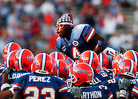 Before the first Florida Gator game after the 911 attack, player #4 Marquand Manuel wears an American Flag bandanna as he leaps onto his teammates prior to the start of their game against rival Tennessee.