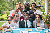 Jarron Brady, seated center, and his family. Graduating seniors and their families and friends attend Brunch with President Jonathan Veitch at Collins House, May 16, 2015. (Photo by Marc Campos, Occidental College Photographer)