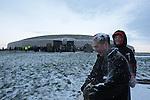 Newgrange Co Meath, 21th December winter solstice, No sun rise this year but a blanket of snow decended on the Tomb in Co Meath. Eolain Downey covers Munich Reilly with Snow..Picture Fran Caffrey /www.newsfile.ie.
