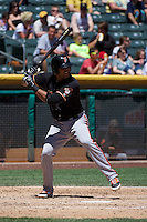 Chris Dominguez (17) of the Fresno Grizzlies at bat against the Salt Lake Bees at Smith's Ballpark on May 26, 2014 in Salt Lake City, Utah.  (Stephen Smith/Four Seam Images)