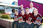 Holy Family School Launch 40 years booklet on Friday. Pictured front L-R Casper Pasier, Jessica Raymond, Keelan Downey and Rayona Downey Back First pupil 40years ago Tony Griffin and Teacher Pat O'Connor