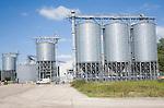 Large steel grain silos for barley at Mendlesham, Suffolk, England