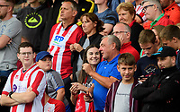 Lincoln City fans watch their team in action<br /> <br /> Photographer Chris Vaughan/CameraSport<br /> <br /> The EFL Sky Bet League One - Lincoln City v Fleetwood Town - Saturday 31st August 2019 - Sincil Bank - Lincoln<br /> <br /> World Copyright © 2019 CameraSport. All rights reserved. 43 Linden Ave. Countesthorpe. Leicester. England. LE8 5PG - Tel: +44 (0) 116 277 4147 - admin@camerasport.com - www.camerasport.com