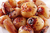 Roast potatoes in their skins and onions food photos