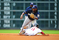 Apr. 30, 2011; Houston, TX, USA: Milwaukee Brewers second baseman Rickie Weeks waits for the throw as Houston Astros base runner Jason Bourgeois in the second inning at Minute Maid Park. Mandatory Credit: Mark J. Rebilas-