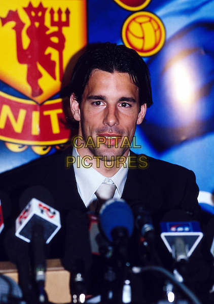 RUUD VAN NISTELRUUY.Manchester United Player Signing.Ref: 0501AT.microphones, headshot, portrait.www.capitalpictures.com.sales@capitalpictures.com.© Capital Pictures.