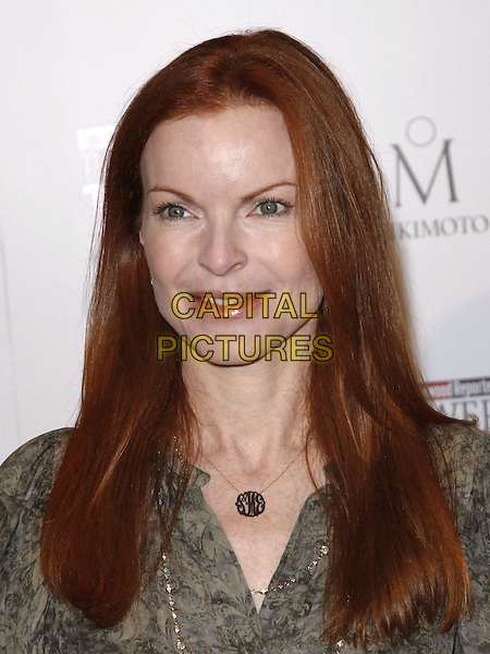 MARCIA CROSS .at The Hollywood Reporter's Annual Women in Entertainment Breakfast held at The Beverly Hills Hotel in Beverly Hills, California, USA, .December 5th 2008.                                                                     .portrait headshot gold necklace green .CAP/DVS.©Debbie VanStory/Capital Pictures