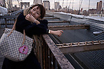 December 2, 2011. A woman getting a portrait made of her on the Brooklyn Bridge.