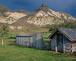 John Day Fossil Beds National Monument, OR<br /> Weathered chicken coop and shed of the historic Cant ranch under the eroded face of Sheep Rock - in the monument's Sheep Rock Unit