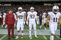SEATTLE, WA - September 28, 2013: Stanford captains  from left Kit Rodgers Ben Gardner, Trent Murphy, second from right, and Shayne Skov stand on the field before play against Washington State at CenturyLink Field.