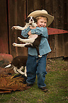 Calf marking at the Wooster Ranch, Red Barn, Calaveras County, Calif...Wesley and the puppies