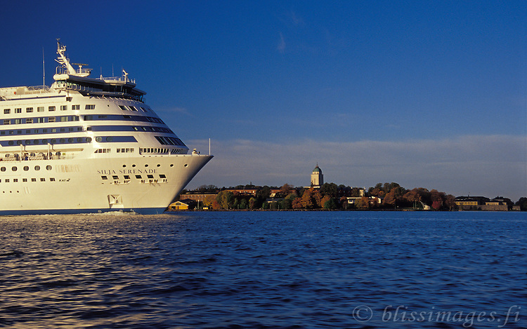 Silja Serenade passes Suomenlinna Lighthouse on a clear, autumn morning in Helsinki, Finland.