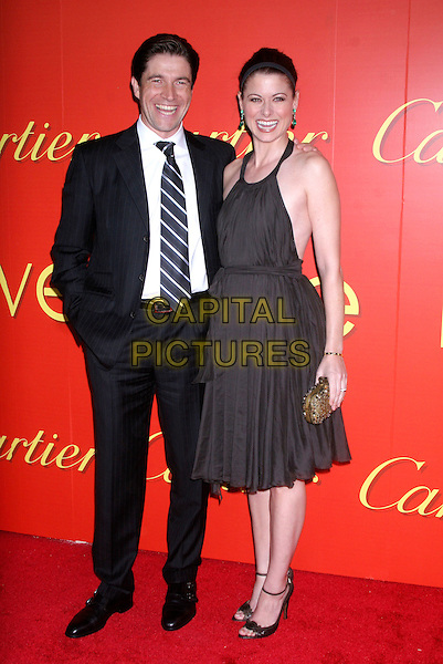 FREDERIC DE NARP (CEO and President of Cartier) & DEBRA MESSING .At the Cartier's Celebration of the Cartier Charity Love Bracelet at the The Cartier Mansion, New York, NY, USA..June 7th, 2007 .full length brown halterneck dress clutch purse alice band headband hand in pocket black suit.CAP/IW.©Ian Wilson/Capital Pictures