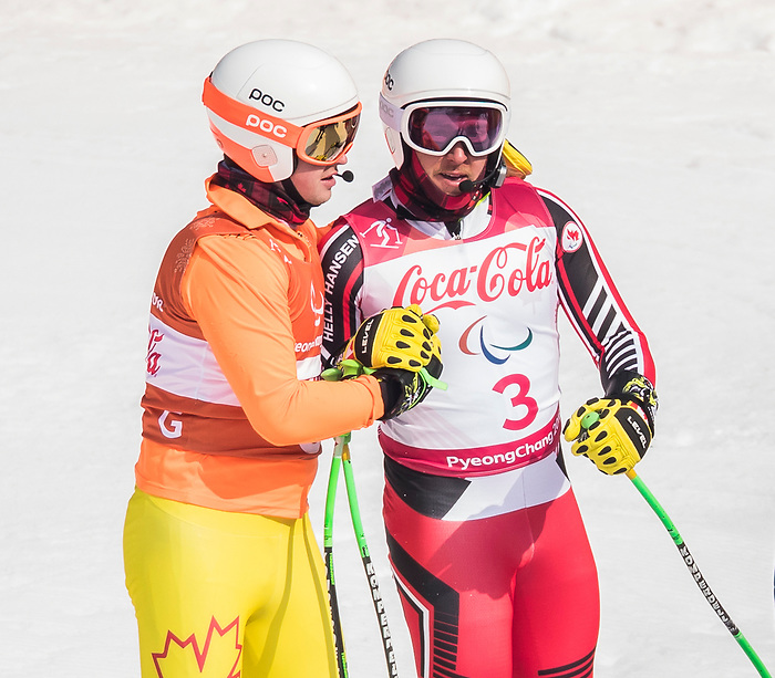 PyeongChang 10/3/2018 - Mac Marcoux and guide Jack Leitch ski to the gold in the men's visually impaired downhill at the Jeongseon Alpine Centre during the 2018 Winter Paralympic Games in Pyeongchang, Korea. Photo: Dave Holland/Canadian Paralympic Committee