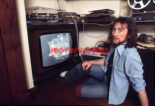 Roger Glover 1975 of Deep Purple at home reviewing Butterfly Ball graphics<br /> &copy; Chris Walter