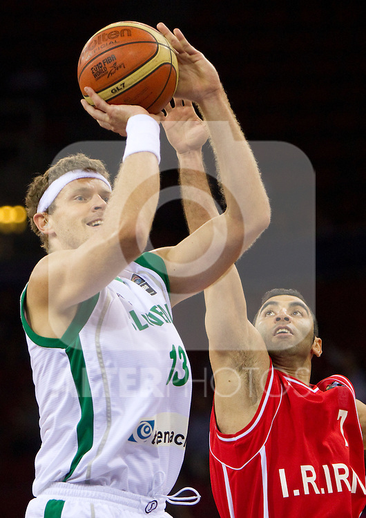 02.09.2010, Abdi Ipekci Arena, Istanbul, TUR, 2010 FIBA World Championship, Slovenia vs Iran, im Bild Miha Zupan of Slovenia vs Mahdi Kamrany of Iran during  the Preliminary Round - Group B basketball match between National teams of Slovenia and Iran. EXPA Pictures © 2010, PhotoCredit: EXPA/ Sportida/ Vid Ponikvar *** ATTENTION *** SLOVENIA OUT!
