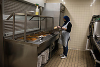 NEW YORK CITY, NY - MAY 05: Staff member cooks food to distribute to needy residents of NYC through emergency food programs on May 05,2020. Food inequality effects 2 million residents in the city , according to a study by Hunger Free America. (Photo by Joana Toro /VIEWpress)