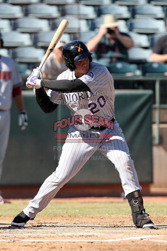 Salt River Rafters outfielder Nolan Arenado #20 during an Arizona Fall League game against the Phoenix Desert Dogs at Phoenix Municipal Stadium on November 1, 2011 in Phoenix, Arizona.  Salt River defeated Phoenix 10-7.  (Mike Janes/Four Seam Images)