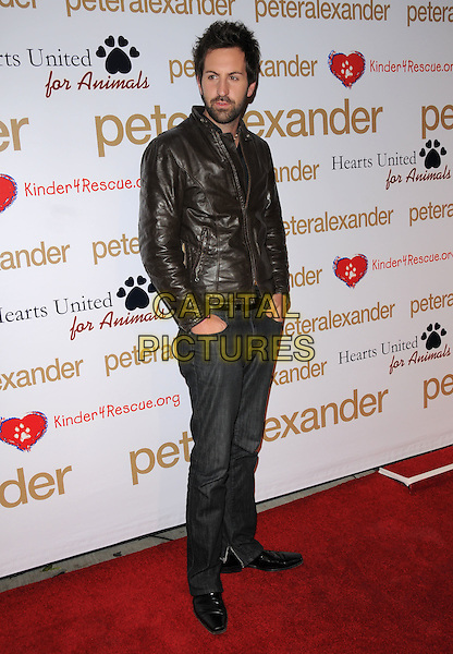 "JOSH KELLEY.The Peter Alexander Flagship Boutique Opening on Robertson Blvd. and announcement of The Charity PJ Collection inspired by Katherine Heigl's dog ""Romeo"" in Beverly Hills, California, USA. .October 22nd, 2008    .full length brown leather jacket beard stubble facial hair jeans denim .CAP/DVS.©Debbie VanStory/Capital Pictures."