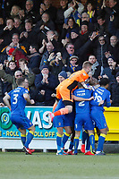 GOAL - Joe Pigott of AFC Wimbledon is mobbed after scoring the winner during the Sky Bet League 1 match between AFC Wimbledon and Bristol Rovers at the Cherry Red Records Stadium, Kingston, England on 17 February 2018. Photo by Carlton Myrie.