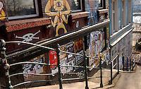 Poster strewn walls and grafitti.Hamburg, Germany