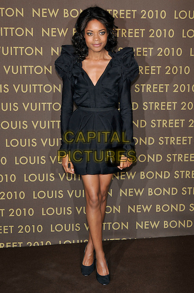 NAOMIE HARRIS .attends the launch of the Louis Vuitton Bond Street Maison in London, England, UK, May 25th, 2010. .full length black puff sleeve dress ruched long sleeved shoes clutch bag v-neck .CAP/PL.©Phil Loftus/Capital Pictures.