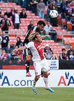 Carlos Ruiz (20) of D.C. United fights for a header with Micael Harrington (5) of the Portland Timbers during a Major League Soccer match at RFK Stadium in Washington, DC.  The Portland Timbers defeated D.C. United, 2-0.