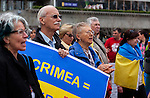 People in the crowd sing the Ukrainian anthem at the Ukrainian rally in Justin Herman Plaza, in San Francisco, California, on Sunday, March 9th, 2014.  Photo/Victoria Sheridan