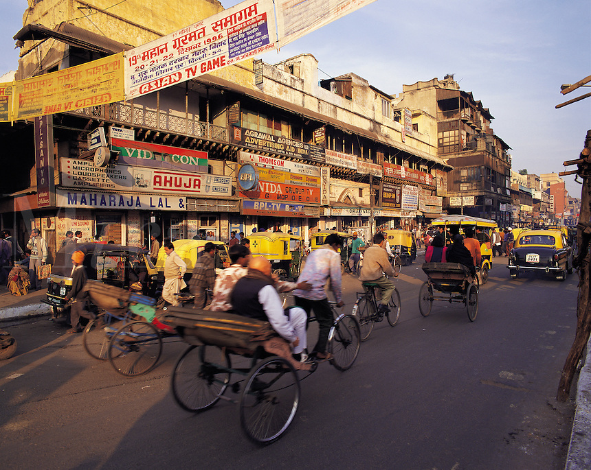 Busy traffic and passers-by in Chandini Chowk market area, central Delhi, Indi