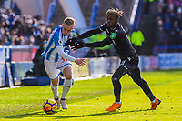 Huddersfield Town's defender Florent Hadergjonaj (33) goes past Crystal Palace's midfielder Wilfried Zaha (11) during the EPL - Premier League match between Huddersfield Town and Crystal Palace at the John Smith's Stadium, Huddersfield, England on 17 March 2018. Photo by Stephen Buckley / PRiME Media Images.