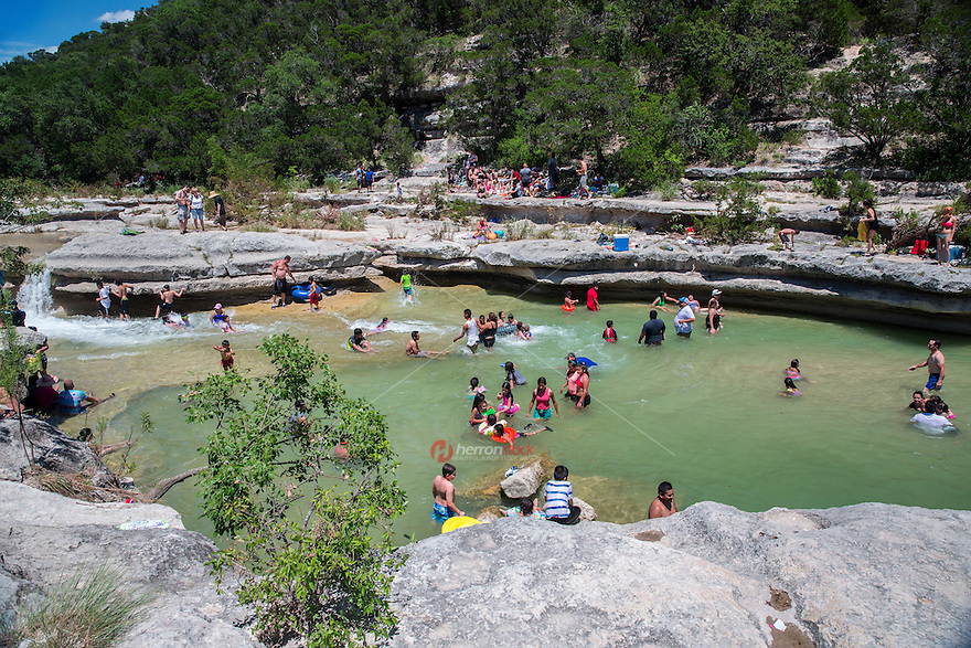 Bull Creek is listed as one of Austin's best swimming holes and a perfect spot to cool off from the brutal Texas heat.