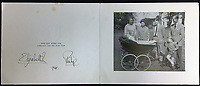 BNPS.co.uk (01202 558833)<br /> Pic: Rowleys/BNPS<br /> <br /> Pictured: 1965 All the children with Edward in the pram.<br /> <br /> <br /> A series of Christmas cards sent by the Royal Family to a married couple on their staff over a 25 year period have sold for £2,000.<br /> <br /> Most of the cards were sent by the Queen and Prince Philip and show the changing face of the monarchy from the black-and-white post war world to the colourful 1970s.<br /> <br /> They were sent to the couple who worked at Balmoral, the wife in the house and the husband on the estate.<br /> <br /> The cards were sold individually with the most expensive being the one for Christmas 1947 which was signed by King George VI and the Queen Mother.