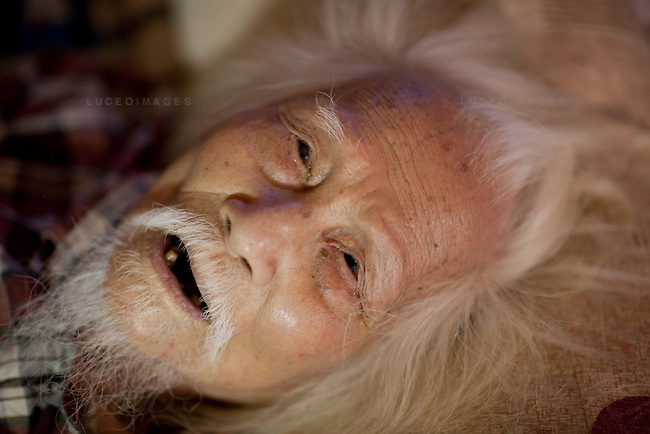 """Photographer Vo An Ninh, now 103 years old, lays practically motionless on a small mattress while his great grandchildren instant message friends on their computers. He looks like a small invalid child with an incredibly weathered face. But this man is one of the pioneering photographers of Vietnam, and he has seen more in his life than I can ever hope for...His photographs caught the essence of the Vietnamese people during the early years of photojournalism. His work during the French occupation and Vietnamese famines serve as historical records for the his nation. His access to Ho Chi Minh during war times as a photographer was impressive...In 1972, American b-52 bombers continuously hit Hanoi. Hanoians called this time the """"Sleepless Nights"""". Despite government curfew orders during the air raids, many photographers stayed out to photograph. Vo An Ninh was one of those photographers. He was said to be very calm, riding a bicycle at a leisurely pace, with a helmet hanging from one handle bar and a canvas saddle bag on the other...His camera of choice, the Super Ikonta A - A Japanese 120 film rangefinder introduced in the 1950's. Many photographers offered him newer cameras but he would just laugh and ask, """"Why would I use one of those when I have this one?""""..For his contributions to photography in Vietnam, Vo An Ninh has been awarded the Anti-US Order, Second Class; the Labour Order, Second Class; the Independence Order, Third Class and most recently, the coveted Ho Chi Minh Award."""