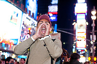 "An announcement is made by a protester with ""Occupy Wall Street"" in Times Square to proceed to Washington Square Park on October 15, 2011 in New York City.  While crowd estimates numbered in the tens of thousands, police tactics (including nets, motor scooters, barricades, arrests, and intimidation by riders on horseback) prevented the crowd, which had been split up, from joining together as one in the middle of Times Square."