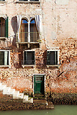 ITALY, Venice. A view of a door of a home along a canal in the Castello district of Venice.