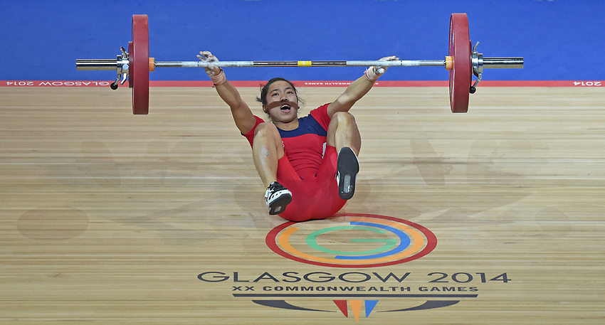 India's Mirabai Chanu Saikhom falls as she has her second attempt lifting 75kg in the women's 48kg weightlifting<br /> <br /> Photographer Chris Vaughan/CameraSport<br /> <br /> 20th Commonwealth Games - Day 1 - Thursday 24th July 2014 - Weightlifting - Clyde Auditorium - Glasgow - UK<br /> <br /> © CameraSport - 43 Linden Ave. Countesthorpe. Leicester. England. LE8 5PG - Tel: +44 (0) 116 277 4147 - admin@camerasport.com - www.camerasport.com
