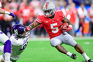 Indianapolis, IN - DEC 1, 2018:Ohio State Buckeyes running back Mike Weber (5) fights off a tackle from  Northwestern Wildcats defensive lineman Samdup Miller (91) during first half action of the Big Ten Championship game between Northwestern and Ohio State at Lucas Oil Stadium in Indianapolis, IN. (Photo by Phillip Peters/Media Images International)