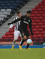 Graham Carey pressures Lassad Nouioui in the St Mirren v Celtic Scottish Communities League Cup Semi Final match played at Hampden Park, Glasgow on 27.1.13.
