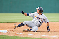 Kale Sumner (23) of the Charleston RiverDogs slides into third base after hitting a triple against the Hickory Crawdads at L.P. Frans Stadium on May 25, 2014 in Hickory, North Carolina.  The RiverDogs defeated the Crawdads 17-10.  (Brian Westerholt/Four Seam Images)