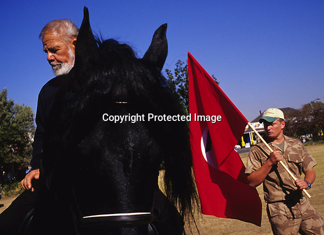 DIPOAFR00103.Politics Right Wing. Man, white, black, uniform, politcs, racist, racism, horse Eugene Terreblanche, the leader of AWB, a right wing movement, greets his followers as he is arriving on his horse, afther being released from prison in central Potchefstrom, South Africa . .©Per-Anders Pettersson/iAfrika Photos
