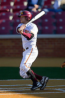 AJ Pettersen #1 of the Minnesota Golden Gophers follows through on his swing against the Towson Tigers at Gene Hooks Field on February 26, 2011 in Winston-Salem, North Carolina.  The Gophers defeated the Tigers 6-4.  Photo by Brian Westerholt / Sports On Film
